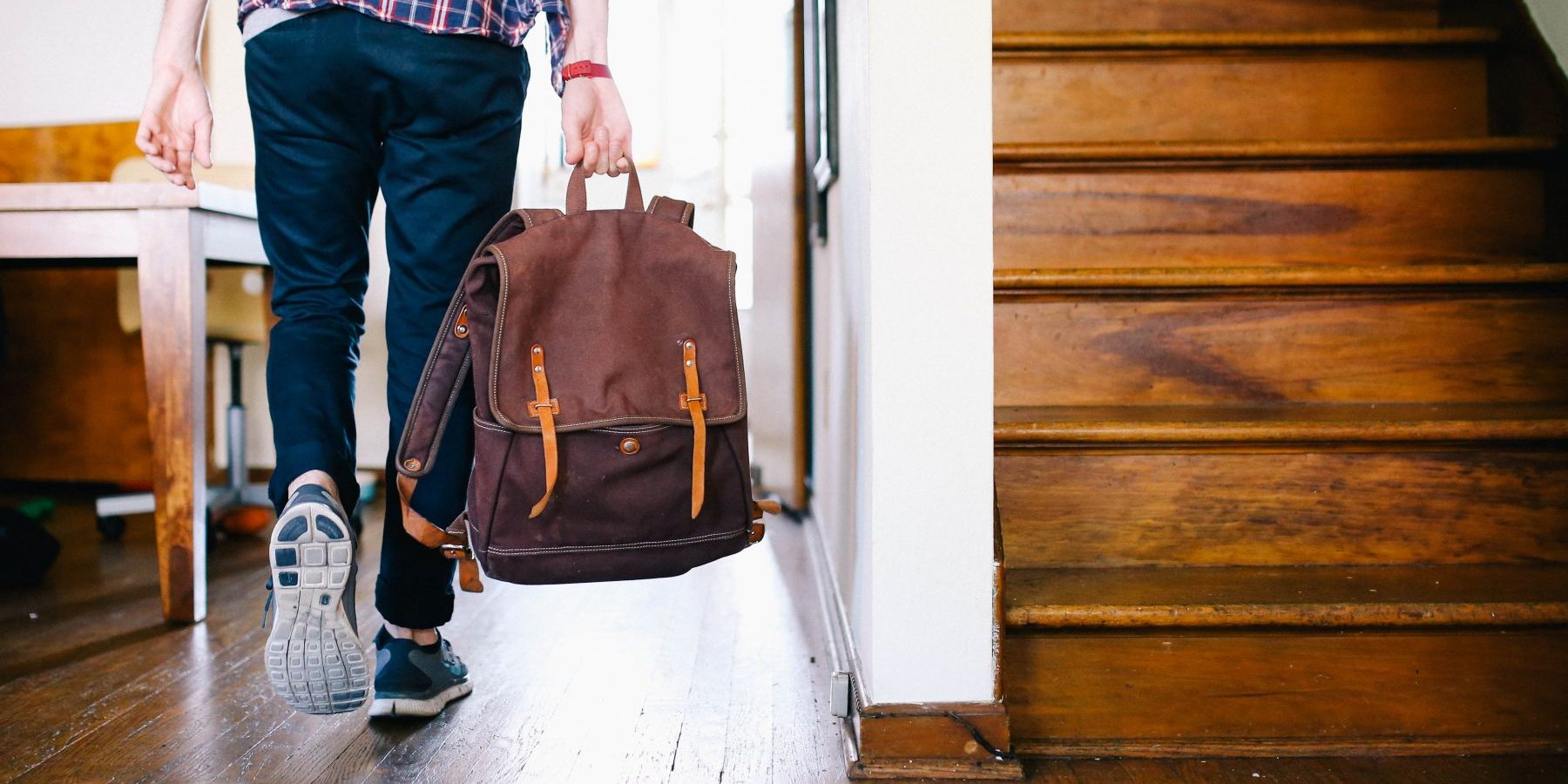 Person with back-pack walking.