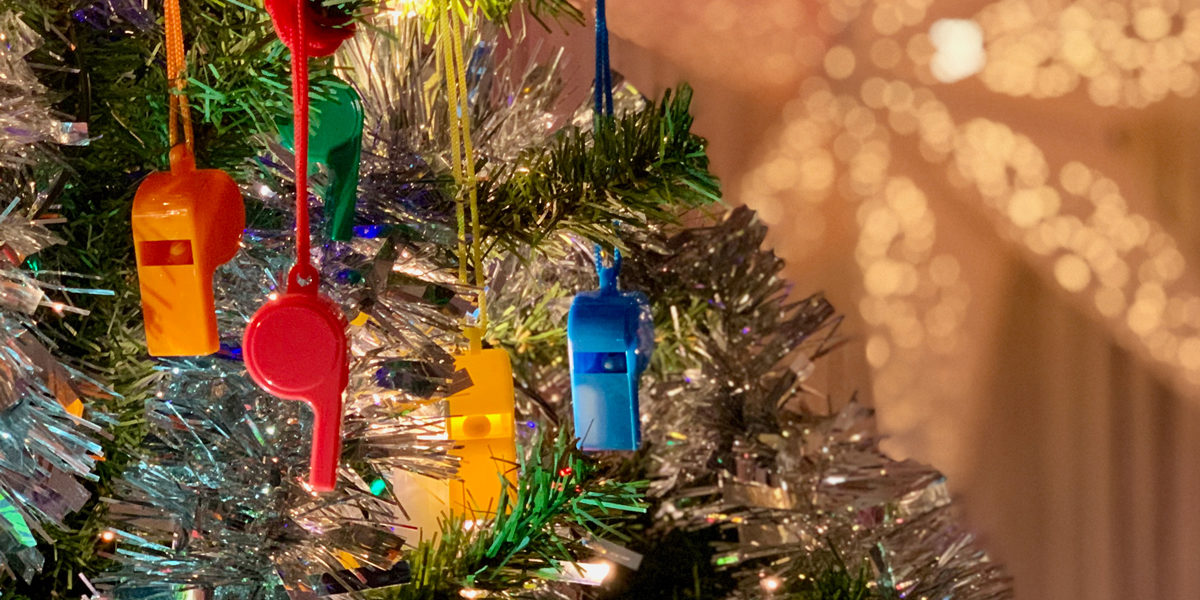 Colourful whistles in a christmas tree